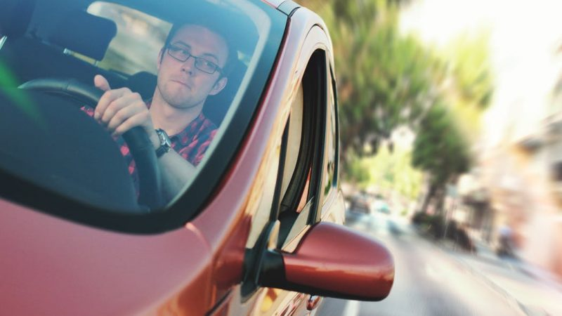 Man Inside The Car While Driving