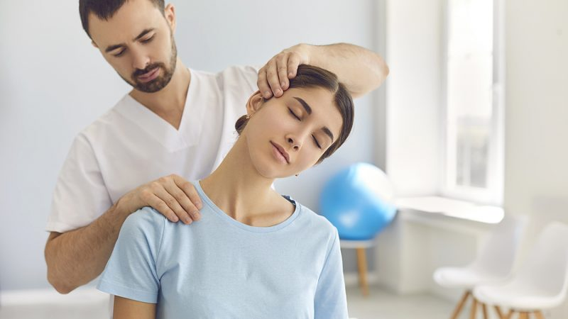 Chiropractor In Castle Hill Treating A Female Patient