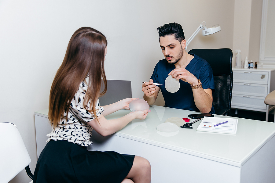 breast surgeon in Mount Waverly showing a breast implant to a female patient