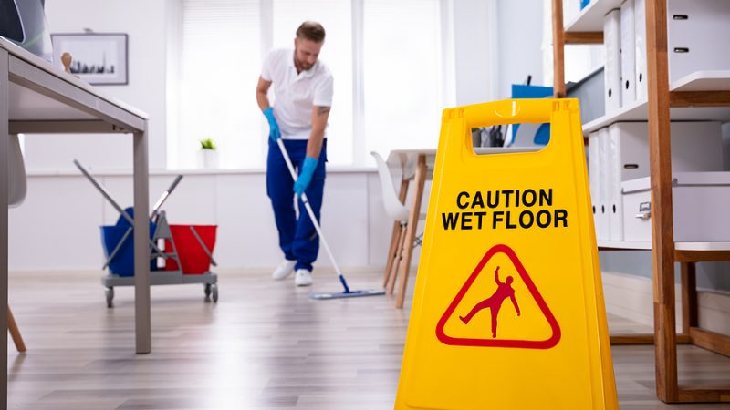 Office Cleaner In Sydney Mopping The Floor