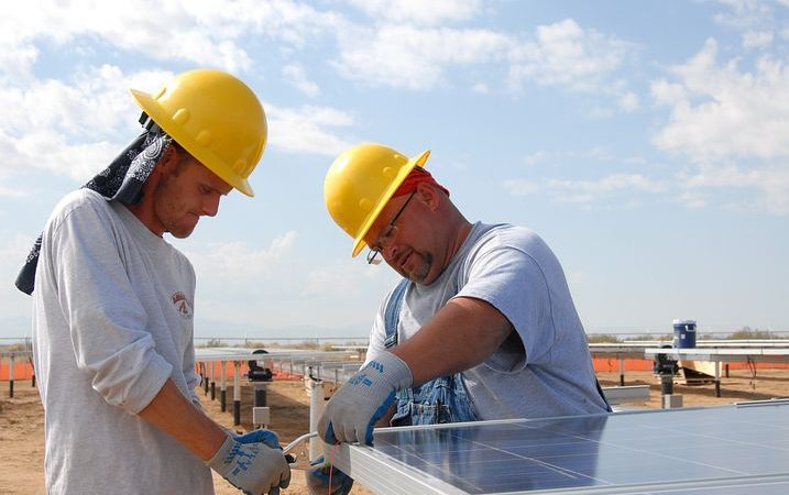 Two Workers Providing Commercial Solar Financing
